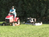 Finish Cut Mower pulled beside a riding mower