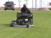Finish Cut Mower pulled beside a zero turn mower